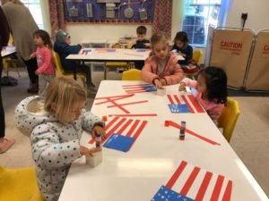 preschoolers making flags for veterans day