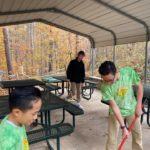Cleaning up the outdoor classroom pavilion for service and sweets