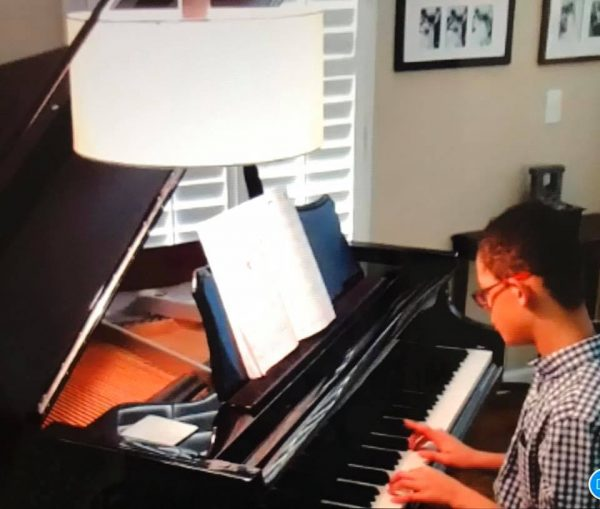 Playing piano in the virtual talent show
