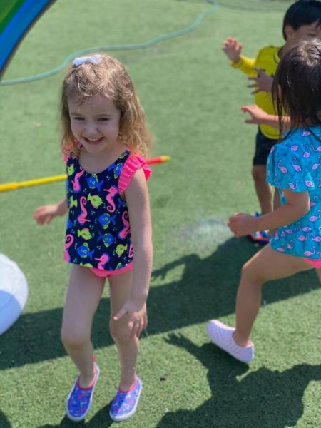 Playing Outside in the Water at Summer Camp